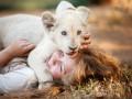Mia un baltā lauva foto 2